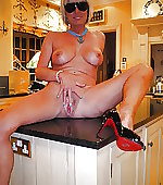 wife kitchen posing